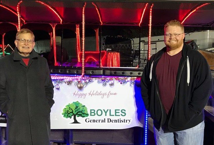 Dr. Franklin and Stephen Boyles by holiday trolley