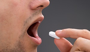 Man taking sedative pill