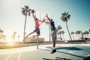 two men playing basketball wearing mouthguards