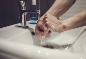 dentist washing their hands with antimicrobial soap