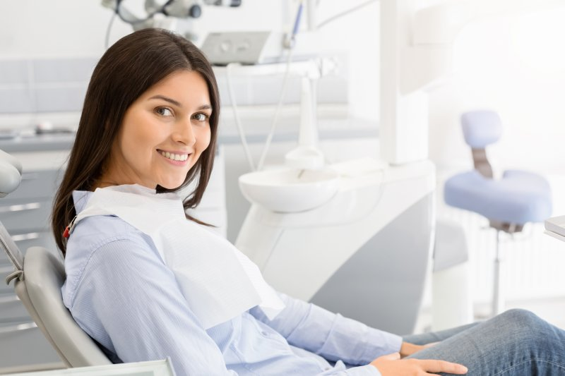 A young woman sitting in the dentist's chair and smiling