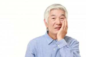 man with tooth pain and a dental emergency